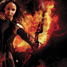 Jennifer Lawrence como Katniss em Jogos Vorazes: Em Chamas